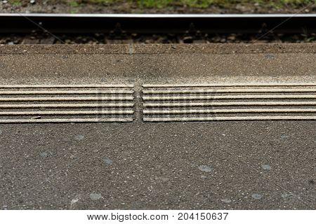 railway station train track white blind people markings