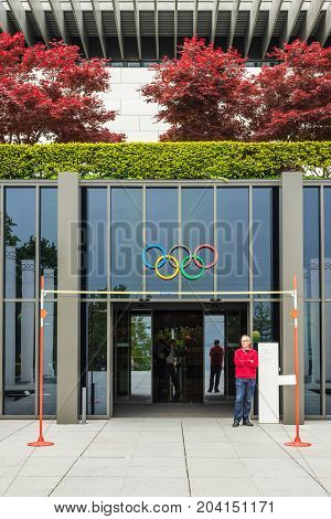 Lausanne Switzerland - May 25 2016: Unidentified man stands near the Entrance in the Olympic Museum in Lausanne Switzerland.
