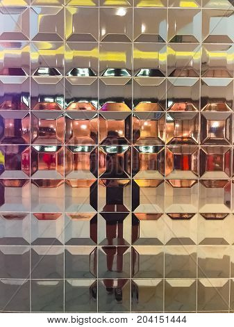 Glass background in shopping mall, colored square texture wall