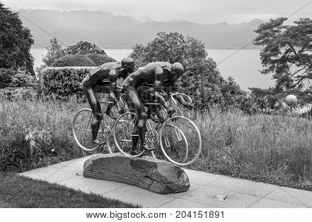 Lausanne Switzerland - May 25 2016: Cyclistes sculpture by Gabor Mihaly at Olympic museum in Lausanne Switzerland on Lake Geneva. Black and white photography.