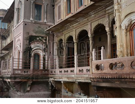 Old buildings on Ganges riverbank at rainy day in Varanasi India.