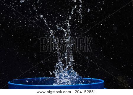water splashes, isolated on a black background.