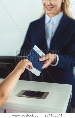 Kid Giving Passport To Staff