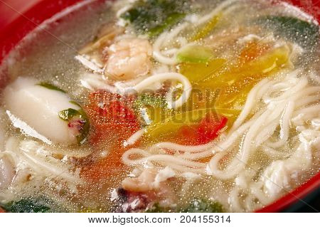 chinese traditional seafood noodle soup  close up meal