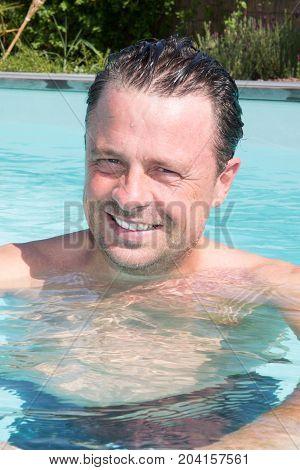 Forties Handsome Man Posing In Swimming Pool