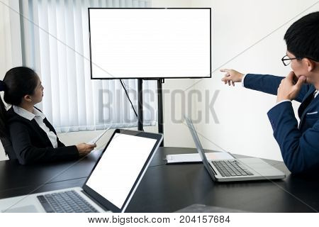 young Businessman working a video conference using a desktop computer of the blank screen