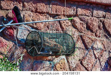 Closeup of fishing net in a harbor in a sunny morning of summer - Bosa - Sardinia - Italy