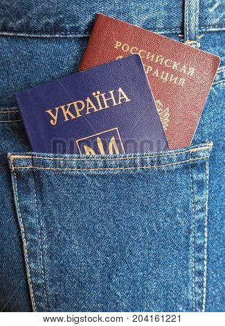 Russian and Ukrainian passports in the back jeans pocket