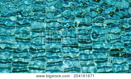 water ripple pattern in pool on sunny day