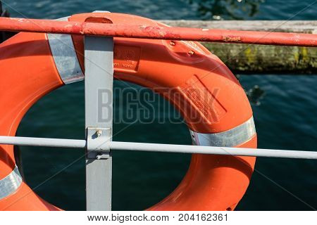 red orange lifebelt attached to a ship close up view
