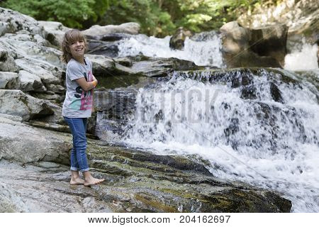 Girl Next To The Waterfall Of The Bucket In The Selva De Irati.