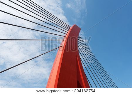 Red cable bridge against blue sky, Chengdu, China