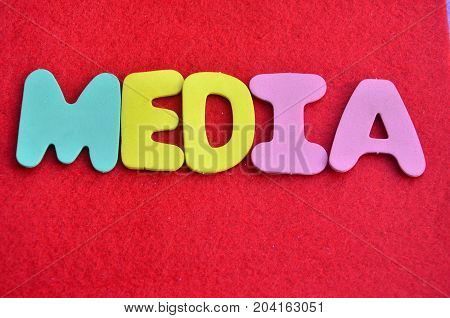WORD MEIDIA ON A  ABSTRACT RED BACKGROUND