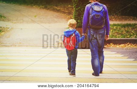 father and son go to school or daycare, child learning