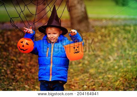 little boy get ready for halloween party outdoors