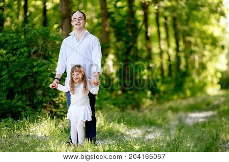 People With Down Sydrome Walking In Forest