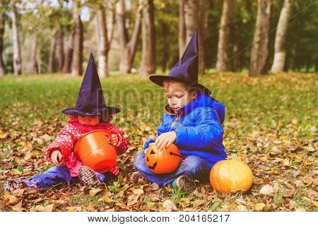 little boy and girl get ready for halloween party, trick or treating