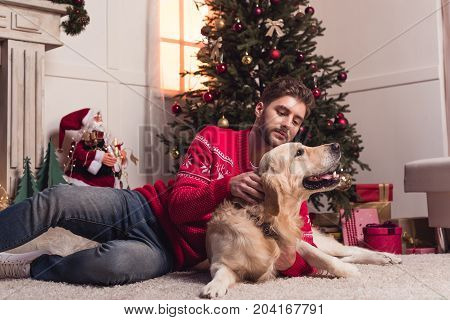 Man Playing With Dog At Christmastime