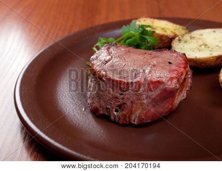 Grilled Beef On White Plate With Potatoes