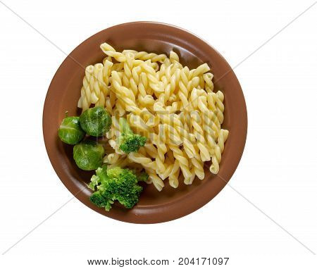 delicious macaroni pasta with vegetableon close up homemade meal