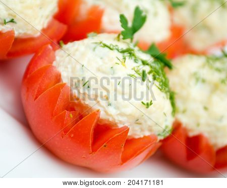 Tomatoes Stuffed with Feta. Shallow depth-of-field. close up homemade meal