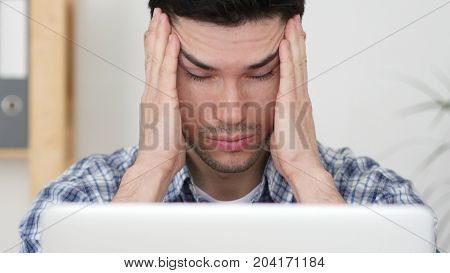 Headache, Man Working On Laptop With Head Pain, Close Up