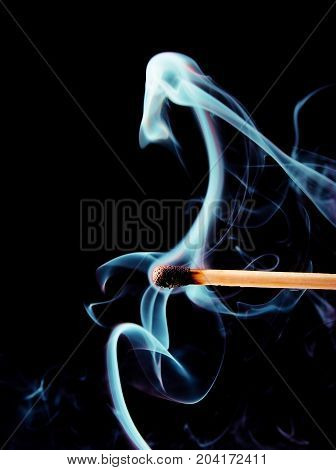 Wooden Match Burning On A Black
