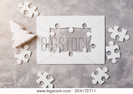 New Year Concept . Frame Of Jigsaw Puzzle On Grey Concrete Background.