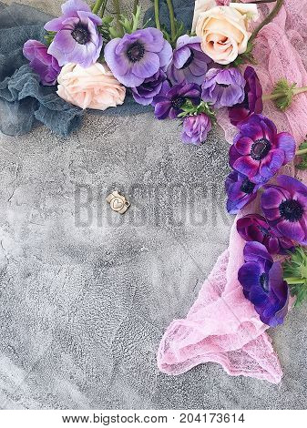 Vintage surface decorated with scarves and flowers