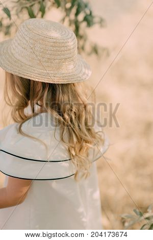 The girl with hat on the field