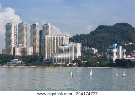 Building and sea in penang , malaysia .