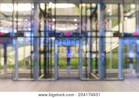 Abstract blurred photo of glass elevation with bokeh background