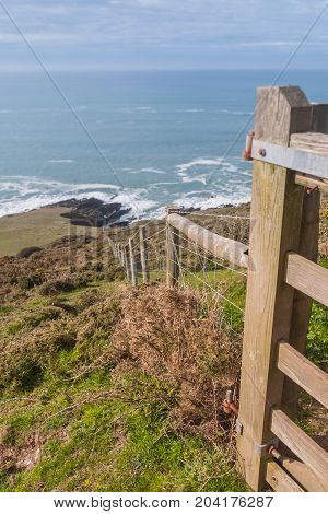 Fence line to the sea. Taken on the South West footpath in Devon, UK.