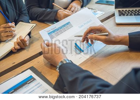 Business consultants is checking and analyzing sales figures to plan business strategies.
