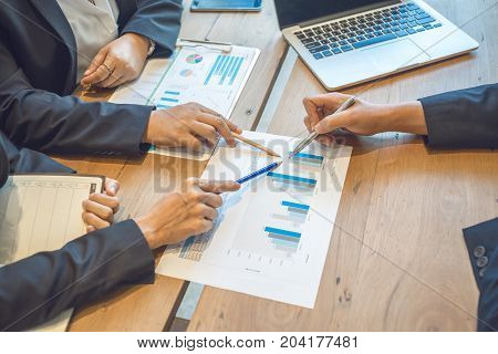 Business consultants is checking and analysis sales figures to plan business strategies.