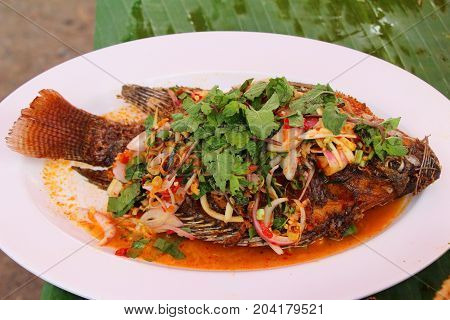 Fried snapper spicy mix vegetable is delicious