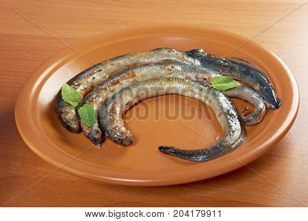 Grilled lamprey  , close up cooked meal