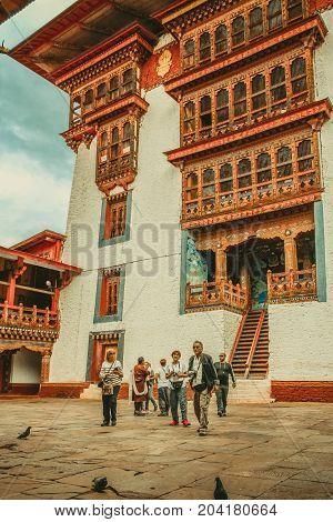 Punakha Bhutan - September 10 2016: Tourists standing in the courtyard of Punakha Dzong Bhutan Asia