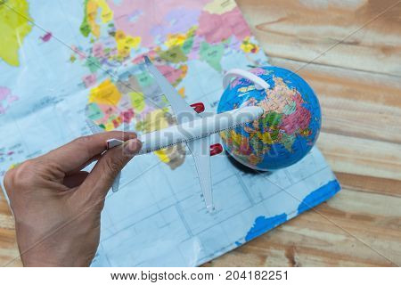 Airplane flying over image photo free trial bigstock airplane flying over the world maprplane made of cinnamon in cappuccino passports gumiabroncs Image collections