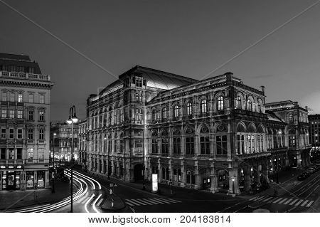 Vienna Austria. View of State Opera in Vienna Austria during the night. Bright blue sky car light trails. Black and white