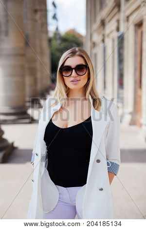 Urban Portrait Of Beautiful Blonde Young Woman In The Street.