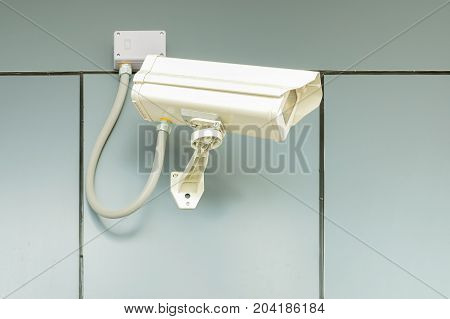 Security camera on home wall, Private property cctv protection.