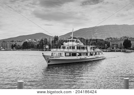 Geneva Switzerland - May 25 2016: Cruise ship named - Henry Dunant by founder of International Committee of the RC Organization based in Geneva harbour in Geneva Switzerland. Black and white photography.