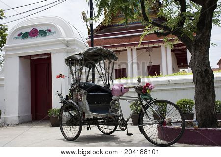 Vintage Retro Tricycle Bike Or Rickshaw Of Thai Style At Front Of Gate Of Wat Songtham Worawihan
