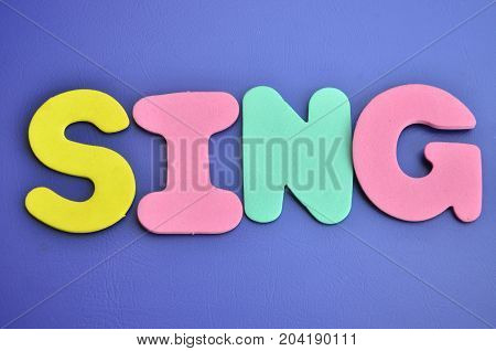 WORD SING ON A  ABSTRACT BLUE BACKGROUND