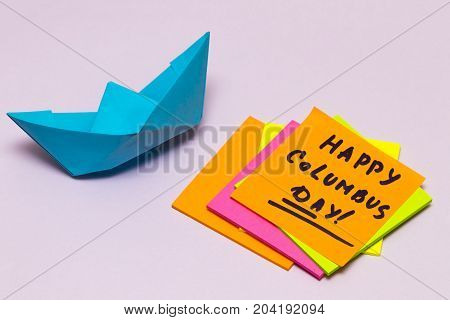 Happy Columbus Day Note With An Orange And A Paper Boat