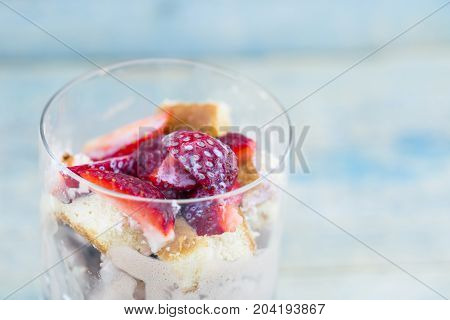 Sweet Dessert From Cheese And Yogurt With Fresh Ripe Strawberry In A Glass Jar, On Rustic Wooden Bac