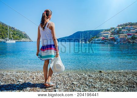 Girl looks at the Assos on the Island of Kefalonia in Greece.