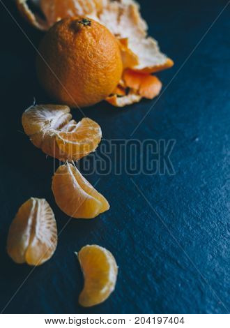 Mandarins on the black background on home table