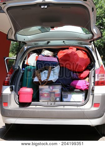 Car With Many Luggage On The Ground And In The Baggage Van ..bef